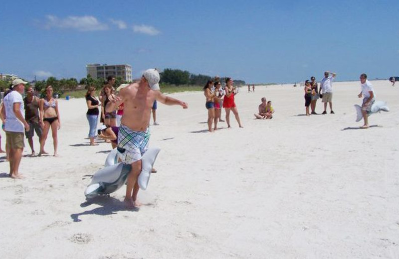 Family time on the beach at Gulf Winds Resort Condominiums.