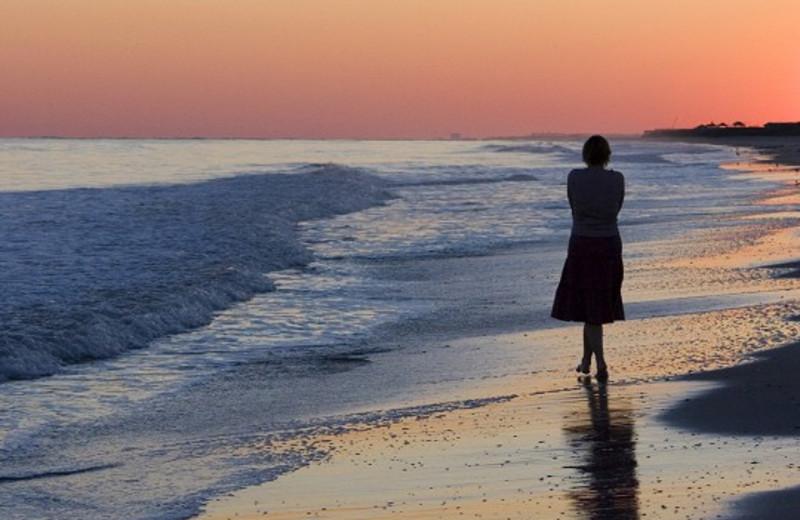 Walking on beach at Ocean Isle Inn.