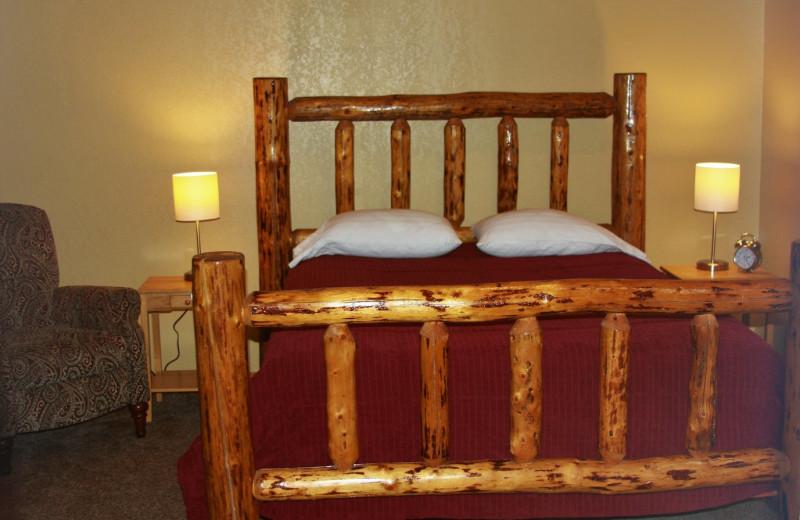 Cabin bedroom at Sleepy Bear Cabins.