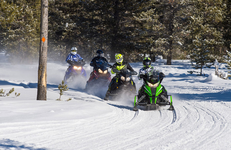 Snowmobiling at Wild Skies Cabin Rentals.