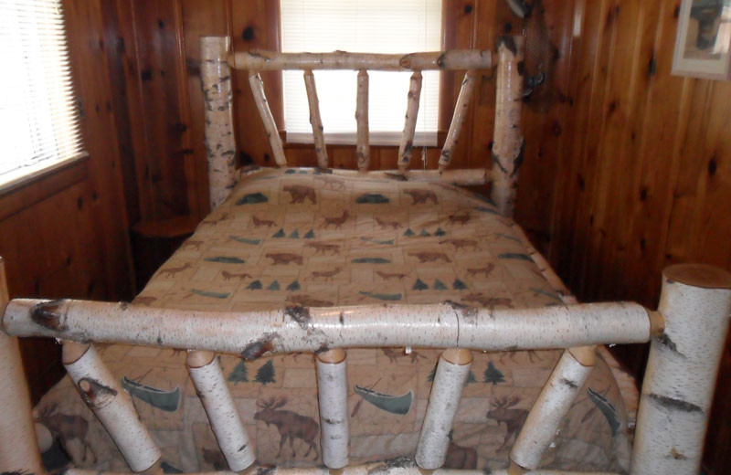 Cottage bedroom at King Creek Resort & Marina.