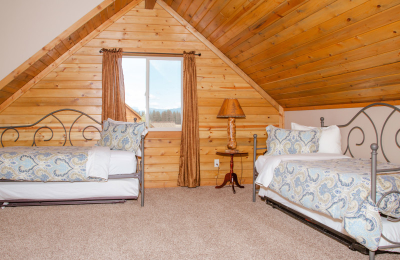 Cabin bedroom at Gentry River Ranch.