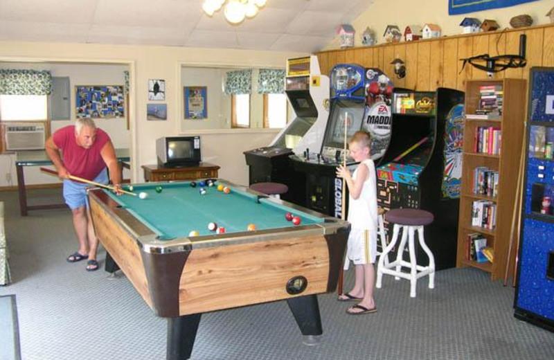 Playing billiards at Robin's Resort.