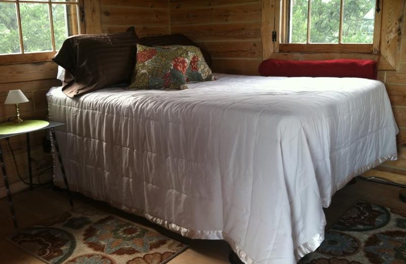 Cabin bedroom at Black Lantern Resort and Retreat.