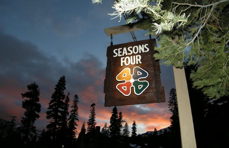 Seasons 4 Condominium Rentals sign.