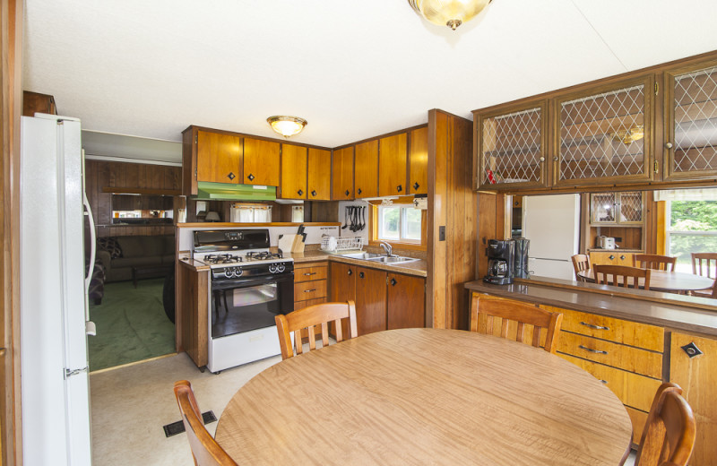 Cottage kitchen at Riverbank Motel & Cabins.