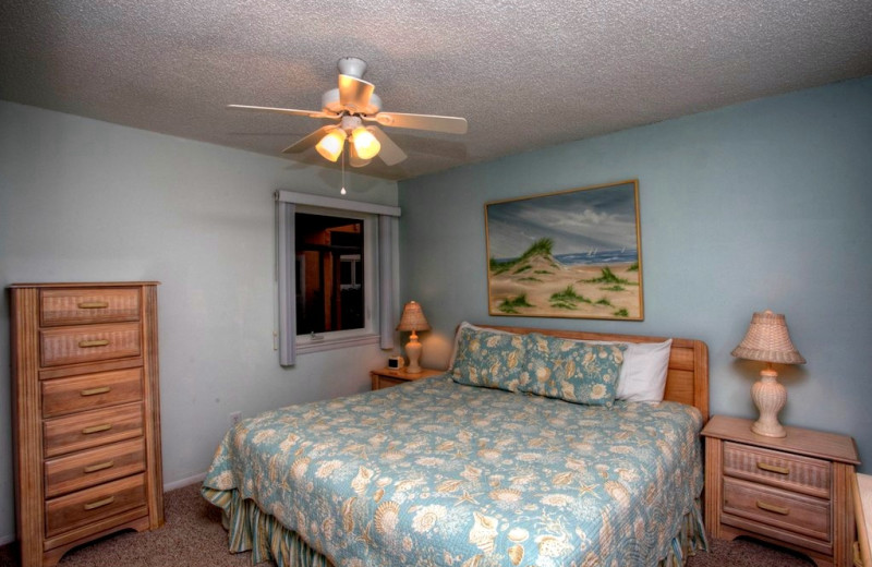 Vacation rental bedroom at Sand Cay Beach Resort.
