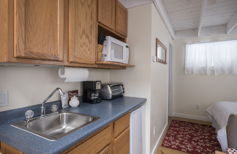 Cottage kitchenette at Sunapee Harbor Cottages.