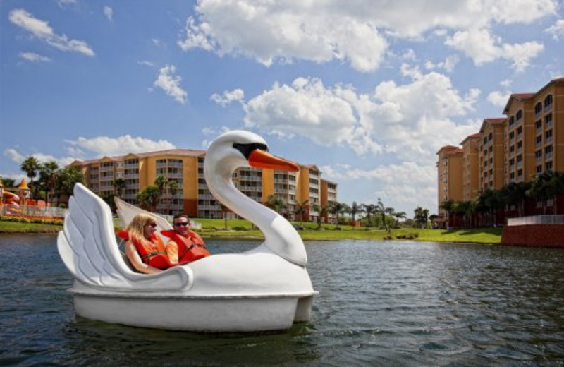 Couple paddle boating at Westgate Vacation.