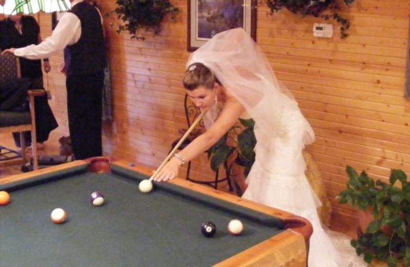 Bride playing pool at Harpole's Heartland Lodge.
