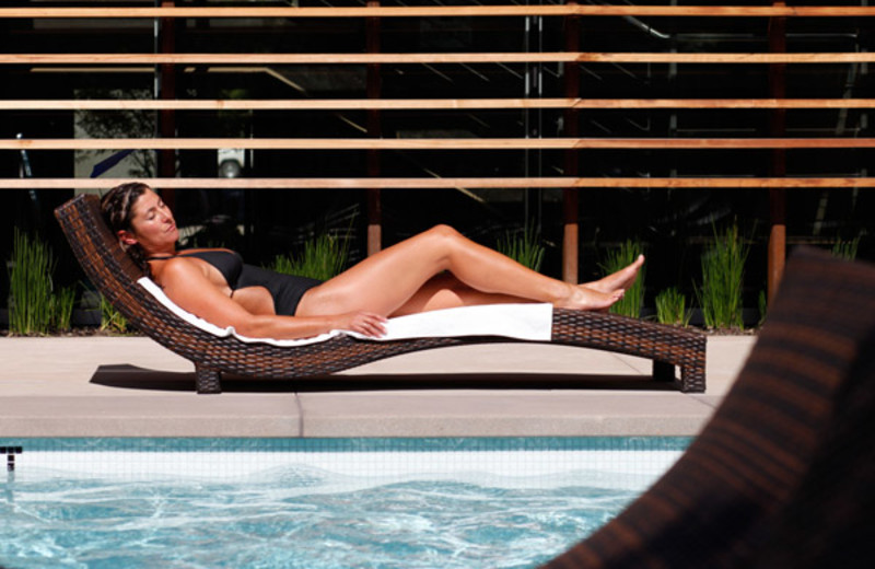 Relaxing by the pool at h2hotel.