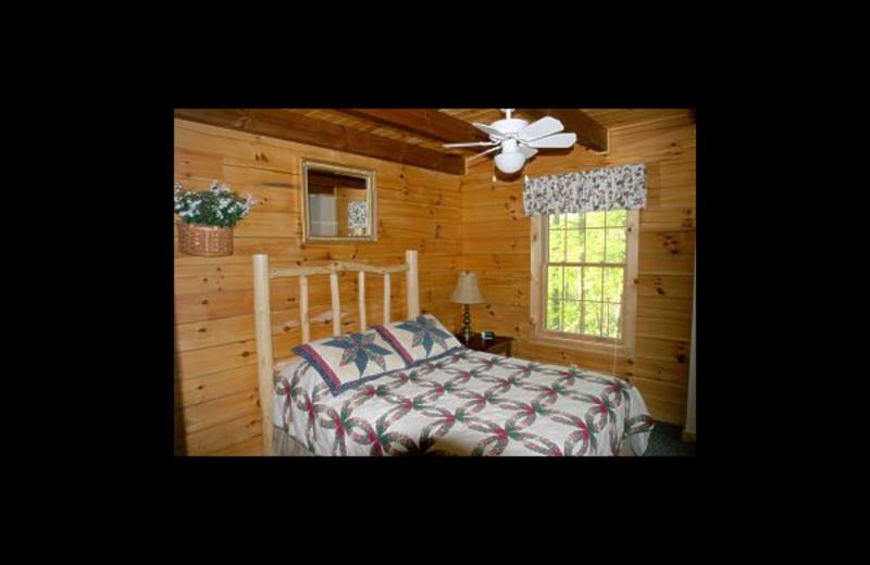 Cabin bedroom at Hummingbird Hill Cabin Rentals.