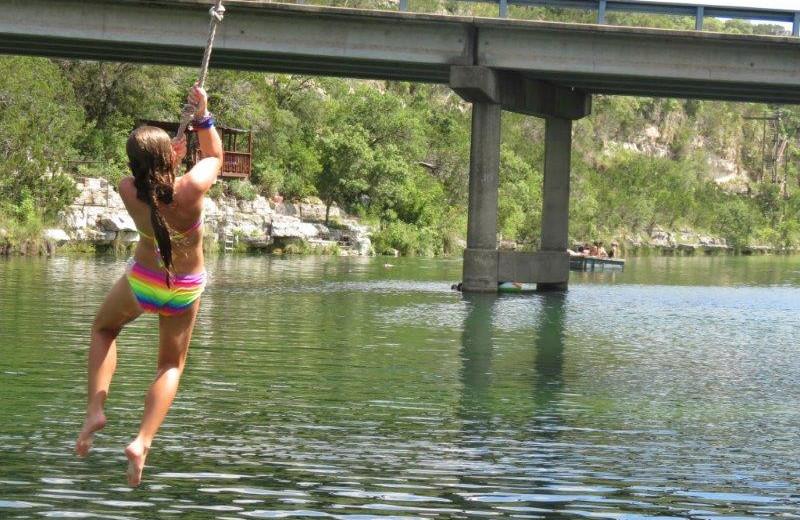 Jumping in river at Mo-Ranch.