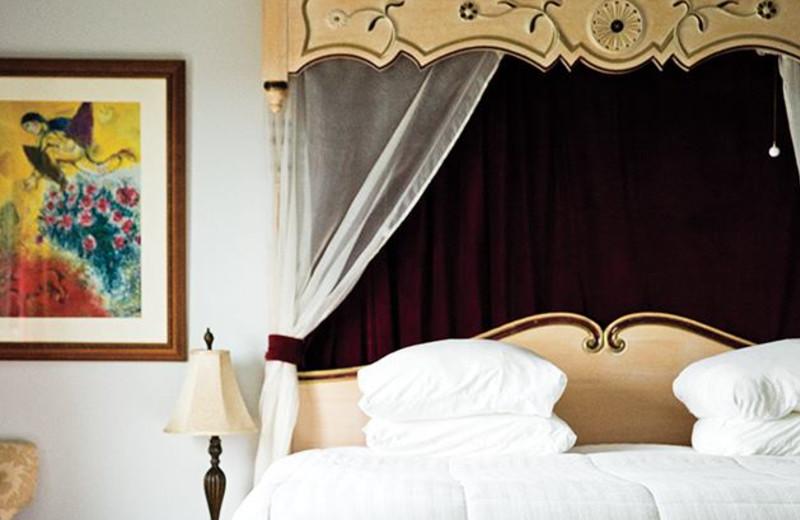 Guest bed at La Tourelle Resort & Spa.