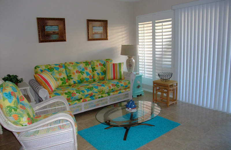 Rental living room at Sand Cay Beach Resort.