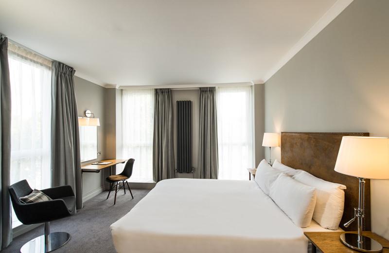 Guest room at GoGlasgow Urban Hotel.