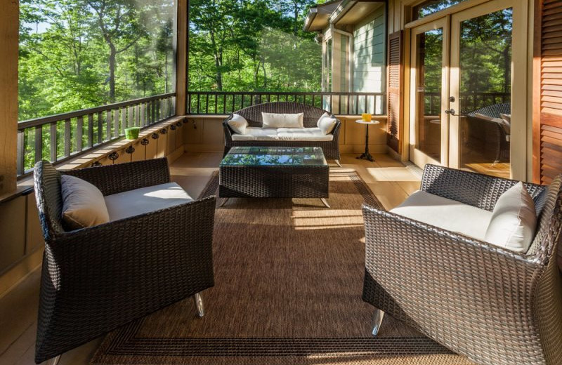 Cabin porch at Mountain Oasis Cabin Rentals.