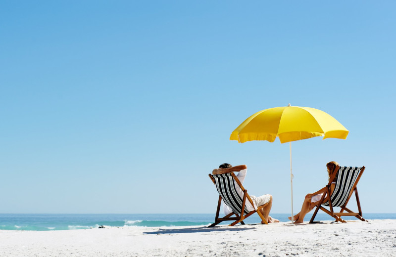 Couple on beach at Bender Realty Vacation Rentals.