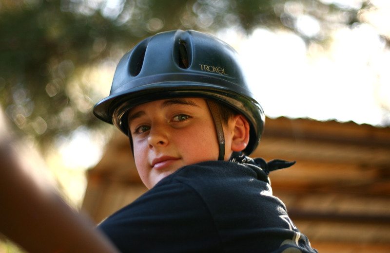Kid riding horse at Marble Mountain Guest Ranch.