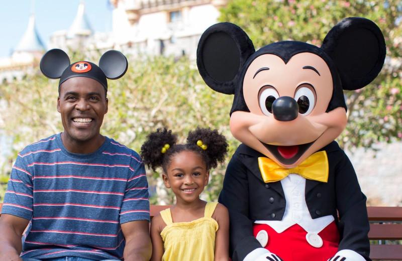 Family at Disney World near Casiola Vacation Homes.