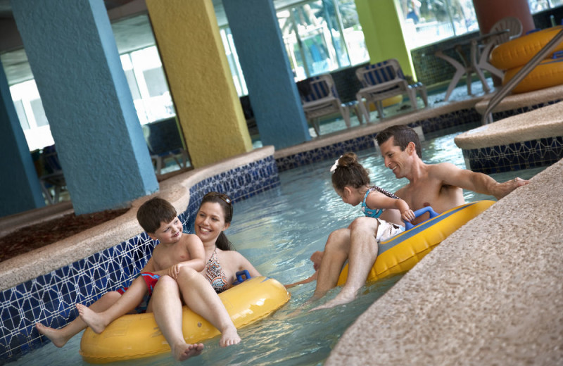 Family on lazy river at Captain's Quarters Resort.