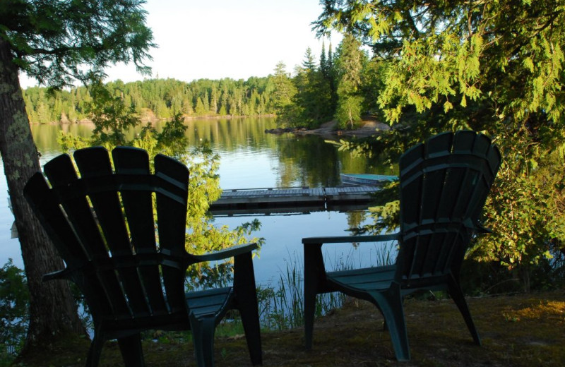 Chairs by lake at Rainbow Point Lodge.