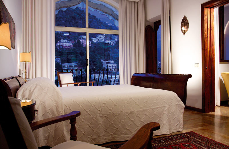 Guest room at Romantik Hotel Poseidon.