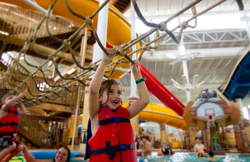 Crossing the monkey bars at Kalahari Waterpark Resort Convention Center.