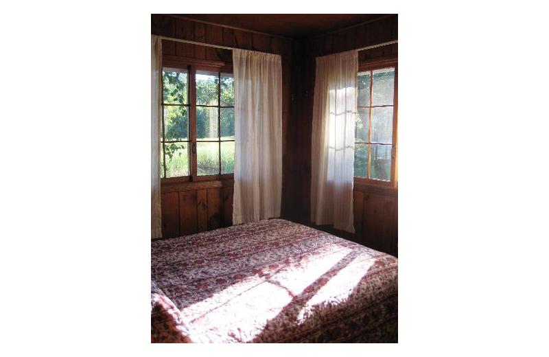 Cabin bedroom at Birch Grove Resort.
