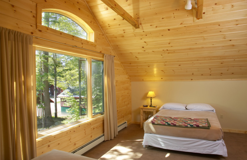Cabin bedroom at New England Outdoor Center.