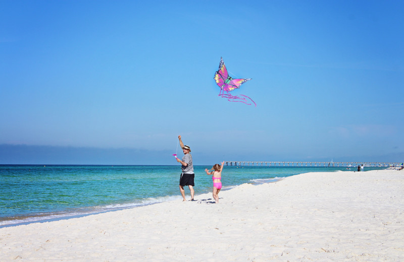 Kids flying kite on beach at Sterling Resorts.