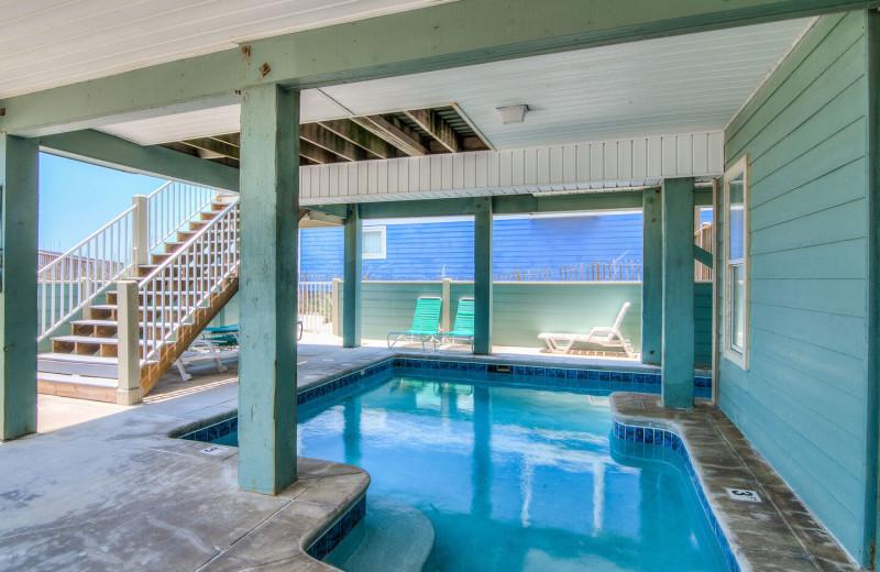 Rental outdoor pool at Sunset Properties.