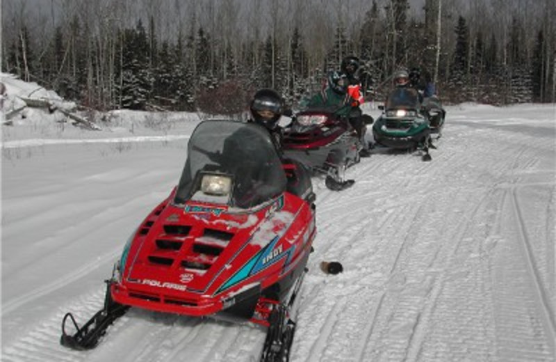 Snowmobiling at Trout Lake Resort.