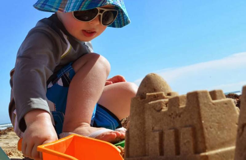 Kid building sandcastle at Seabreeze I.