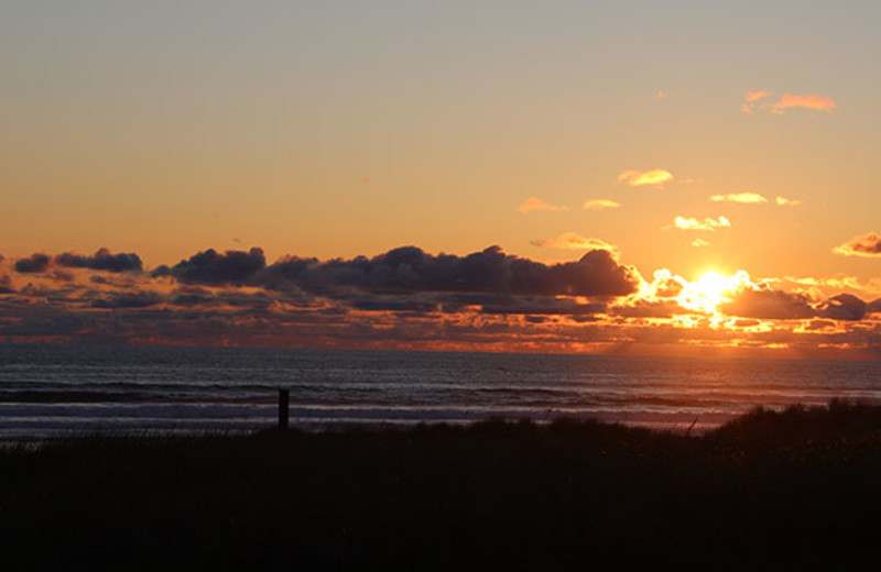 Sunset on the beach at Manzanita Rental Company.