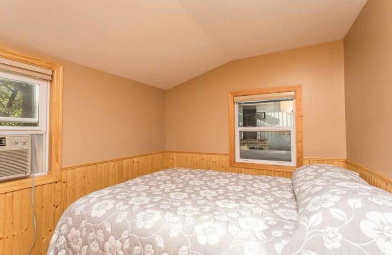 Cabin bedroom at Barrett Lake Resort.