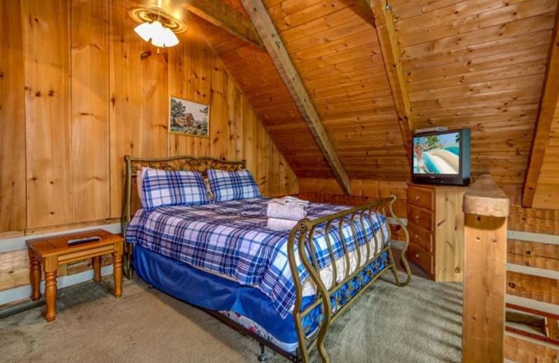 Cabin bedroom at TNT Cabin Rentals.