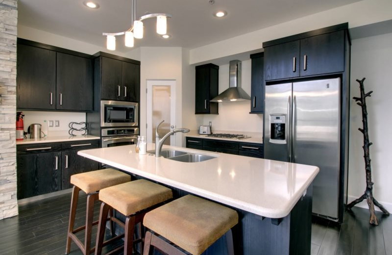 Condo kitchen at Family Time Vacation Rentals.