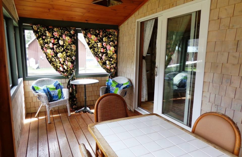 Cottage porch at HighWinds Lodge & Cottages.