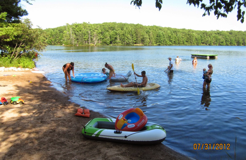 Lake and beach at White Birch Village Resort.