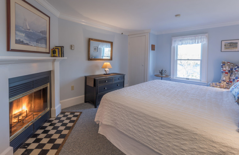 Guest room with fireplace at Five Gables Inn.