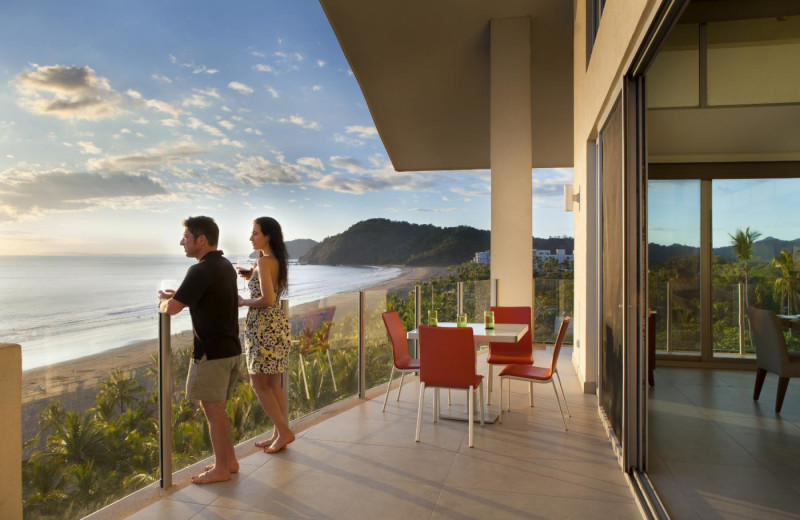 Couple on balcony at Costa Rica Luxury Lifestyle.