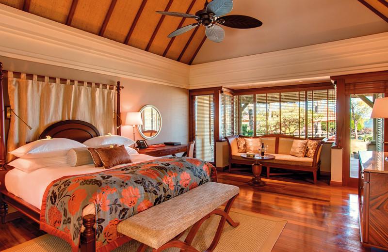Guest room at Belle Mare Plage Golf Hotel & Resort.