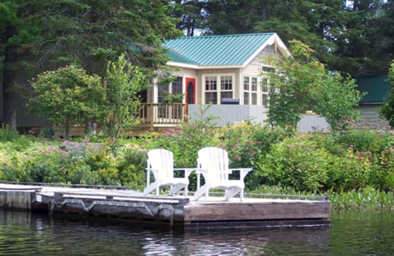 Lakeside Lounging at Woodland Echoes Cottage Resort