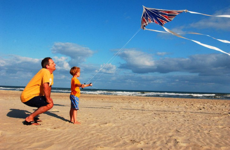Father And Son Flying Kite at Hatteras Realty
