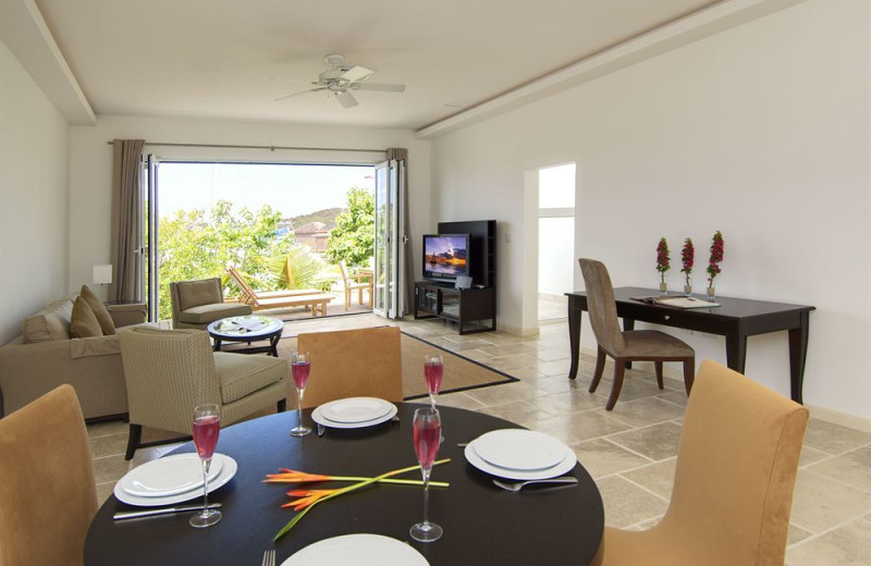 Vacation rental dining and living room at Coral Beach Club.
