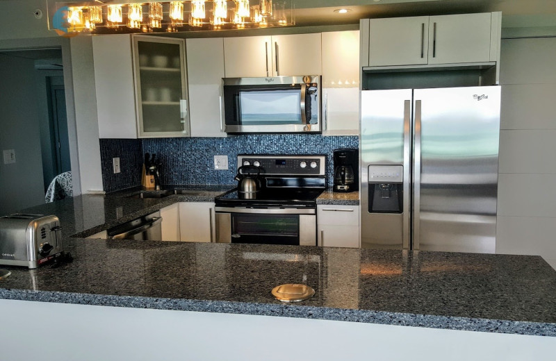 Rental kitchen at HORA Vacation Rentals.