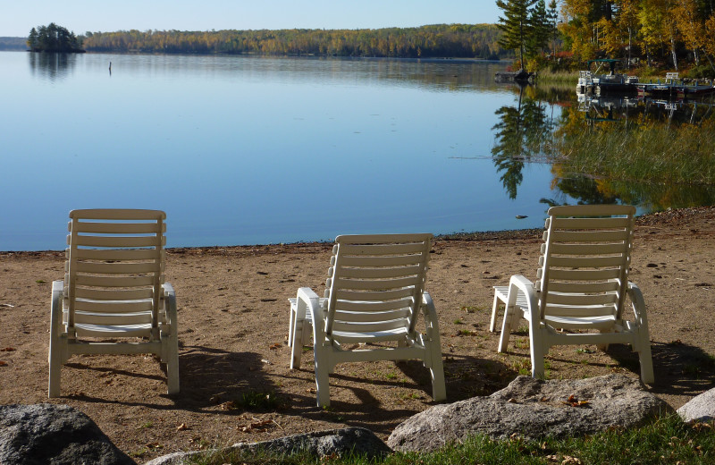 Lounge chairs on the beach at River Point Resort & Outfitting Co.