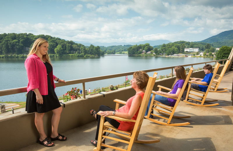 Guests enjoy rocking chairs at The Terrace hotel at Lake Junaluska Conference and Retreat Center.