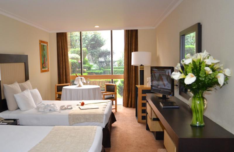 Guest room at Royal Zona Rosa Hotel.
